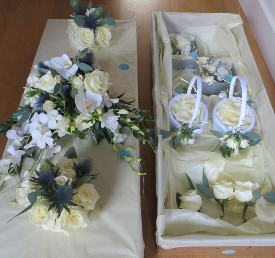 Presentation boxes by Apple Blossom Flowers