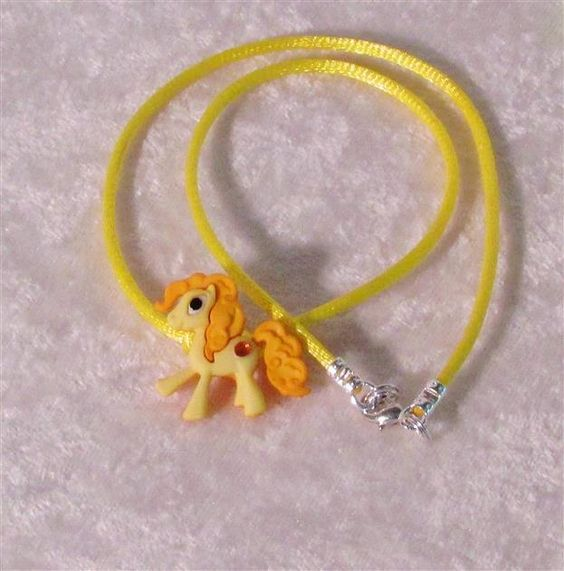 "A Childs adorable little Yellow Pony Necklace a matching bright yellow silk cord with a tiny little yellow rhinestone accent<br/><br/>Cord length  14""  - 16""<br/><br/>Please contact by email if you would like a different cord length"