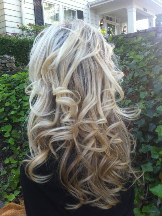 Sock bun curls--- totally easy and beautiful here is a link that actually works http://www.youtube.com/watch?v=3FV-YO46E8Y