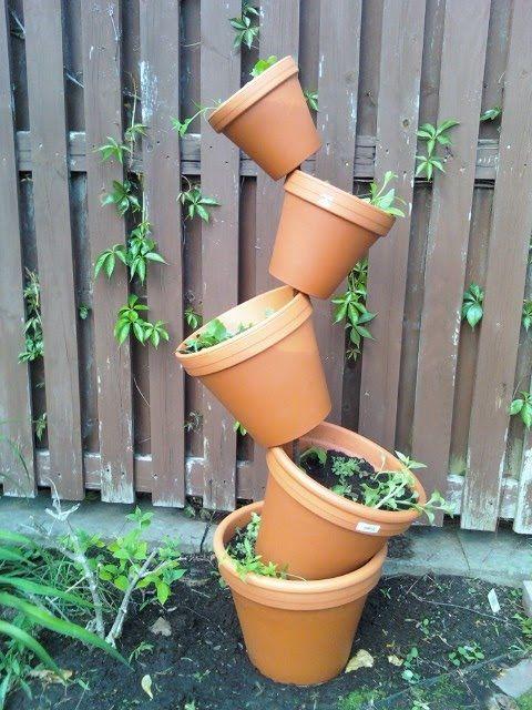 Tipsy Tower Herb Garden garden gardening garden decor small garden ideas diy…