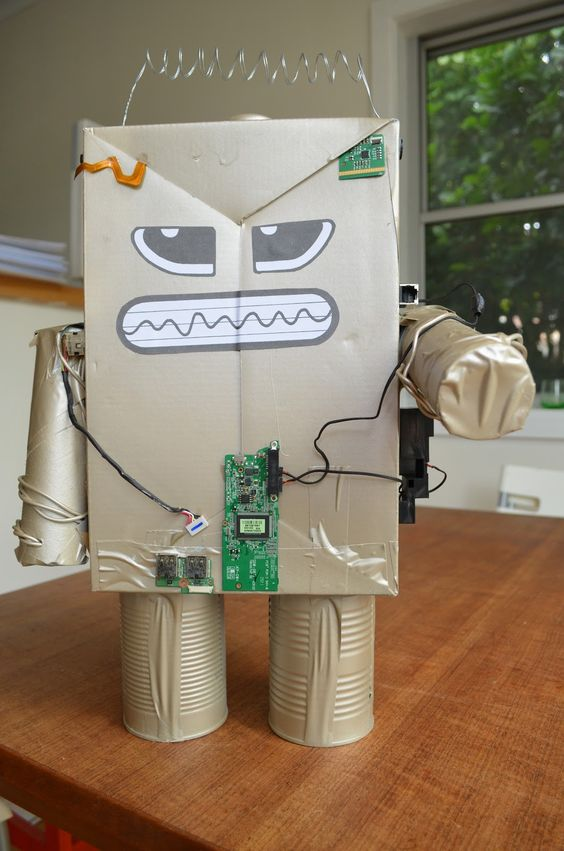 How to build a robot out of recycled materials born for Cool recycled stuff