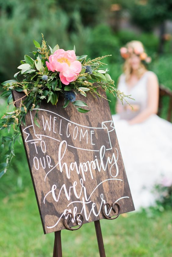 wooden wedding sign with white script: