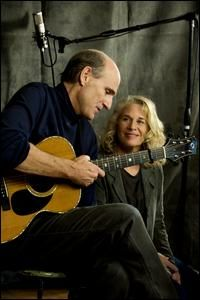 Carol King, songwriter extraordinaire...and some old guy.....ha ha -- that is James Taylor.  That is a whole lotta talent in that picture!