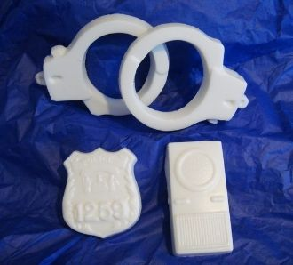 A cute soap gift set for any child or adult. You will receive a set of hand cuffs, a police radio, and a badge all made out of soap. It will be packaged in a clear box with paper shred on the bottom. The box will have a box on top for gift giving.The soaps total weight is 4 1/2 ounces. The box measure 6x4.All Natural White Glycerin Soap
