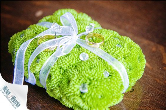 fun, bright alternative to a traditional ring pillow