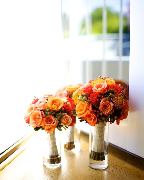 Bouquets in vases during reception.