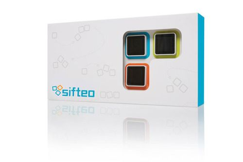 Sifteo Cubes / Pack contains:  - 3 Sifteo cubes  - A charging dock and AC adapter  - Sifteo USB wireless link (delivers games to the cubes)  - Siftrunner software (purchase and run your games)  - Three free games and the Sifteo Creativity Kit™  - 500 Sifteo points to download more games  — $149