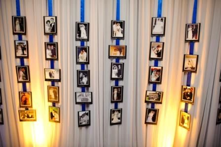 I love the idea of doing something sentimental for the guests. Reception Decoration Idea from The Knot - ask married guests for their wedding picture, mount and hang with ribbon over white draping - guests loved it!