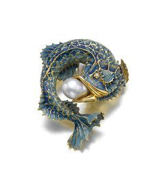 Cultured pearl, enamel and diamond brooch. Designed as a fish with a baroque cultured pearl in its mouth, the scales applied with iridescent blue enamel, the eyes inset with brilliant-cut diamonds.: