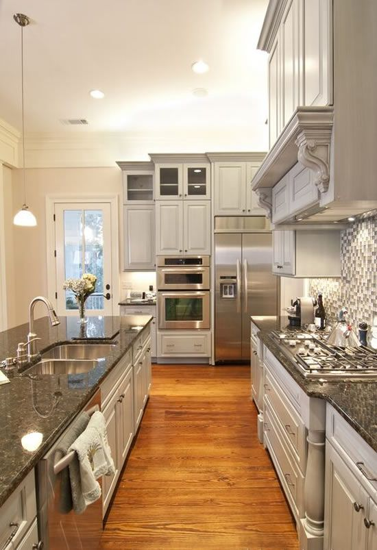 Dark, granite countertops, Grey cabinets. Love it!