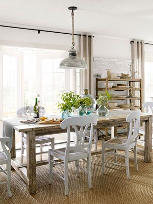 """Country Living Budget Dining Room. Emily and Michael Knotts relied on tag-sale scores, basic hardware-store buys, and a can-do, DIY attitude when renovating their North Carolina lake house. The results redefine the word """"homemade."""""""