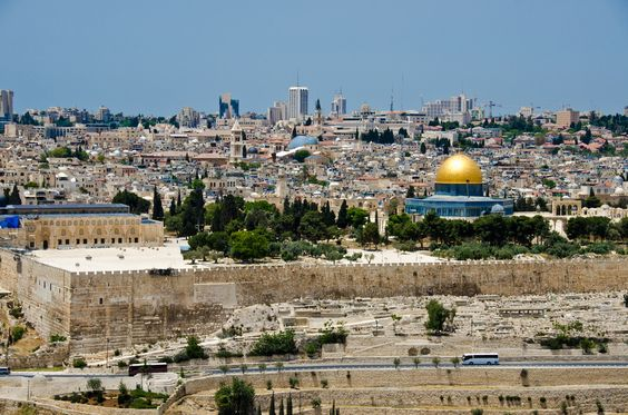 The Mount of Olives is a mountain ridge in East Jerusalem with three peaks running from north to south. The highest, at-Tur, rises to 818 meters. It is named for the olive groves that once covered its slopes. The Mount of Olives is associated predominantly with Jewish and Christian traditions but also contains several sites important in Islam. The mount has been used as a Jewish cemetery for over 3,000 years and holds approximately 150,000 graves.