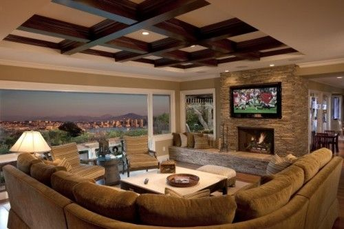 view. fireplace. ceiling beams. couch.