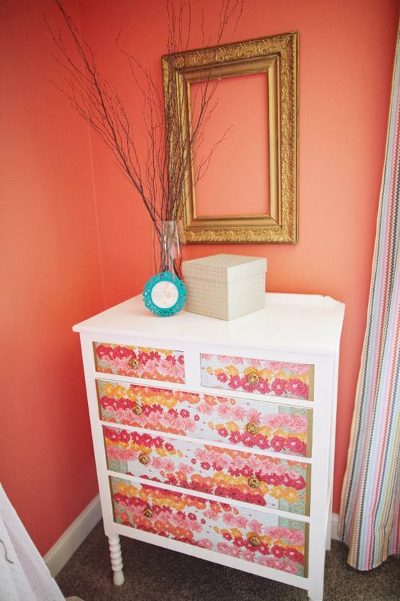This dresser is a garage sale find, decoupaged with... wrapping paper! Fantastic #DIY! #nursery