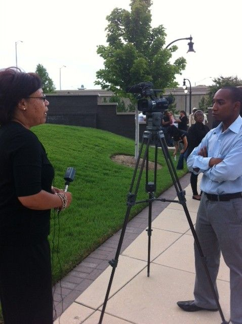 Felicia Collins Correia, our CEO, being asked about the purpose of the vigil.
