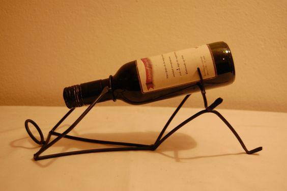 souveniers porta botellas en hierro con forma de hombre