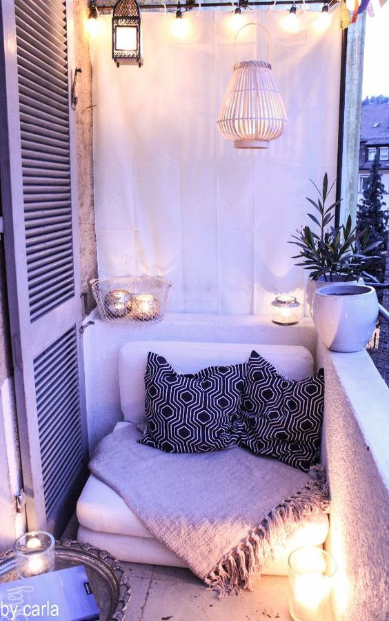 We love how this small balcony was transformed into an incredibly cozy, romantic space. Hang a curtain, fill it with candles, and decorate with bohemian throw pillows from Redbubble.com.