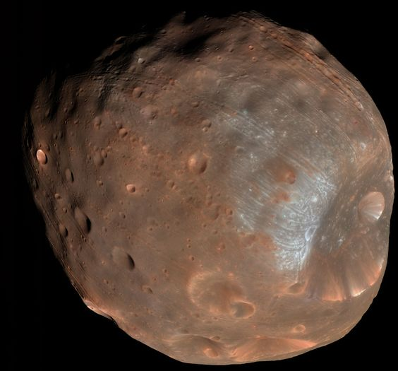 Phobos: Doomed Moon of Mars. This moon is doomed. Mars, the red planet named for the Roman god of war, has two tiny moons, Phobos and Deimos, whose names are derived from the Greek for Fear and Panic. These martian moons may well be captured asteroids originating in the main asteroid belt between Mars and Jupiter or perhaps from even more distant reaches of the Solar System.