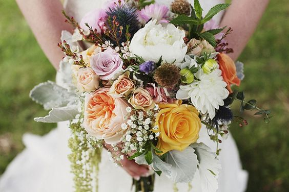 rustic and wonderful bouquet with dahlia, garden roses, spray roses, waxflower, dusty miller, hanging amaranthus and thistle