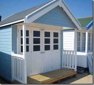 Tiny beach hut; I really like the folding table & chairs idea.