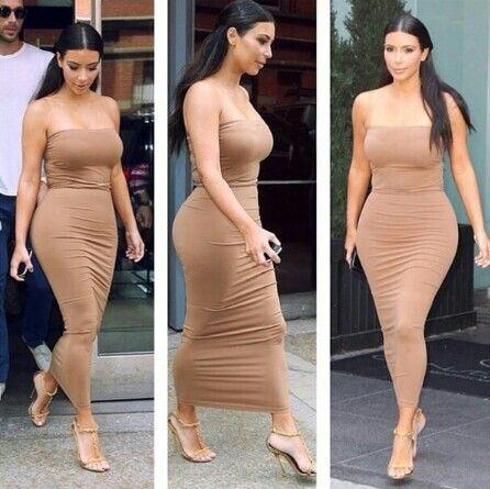 Kim Kardashian looking beautiful in a skin tight tan dress. E ...