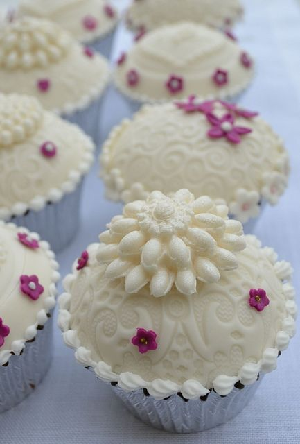 Like the loveliest pale ivory hued, beaded wedding dress transformed into a cupcake. #cupcake #wedding #food #white #dessert #cake