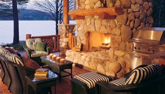 Cozy outdoor fireplace structure built with white cedar products.