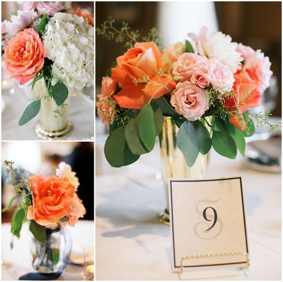 Pretty coral, peach, pink, white, and green centerpieces in silver julep cups. Wedding color palette: navy, grey and coral