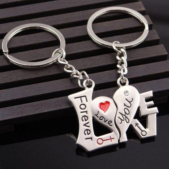 Romantic heart keychains to keep or give as a gift for you and your loved ones. This trinket gifts features rhodium plated cut out key chain with engraved lette