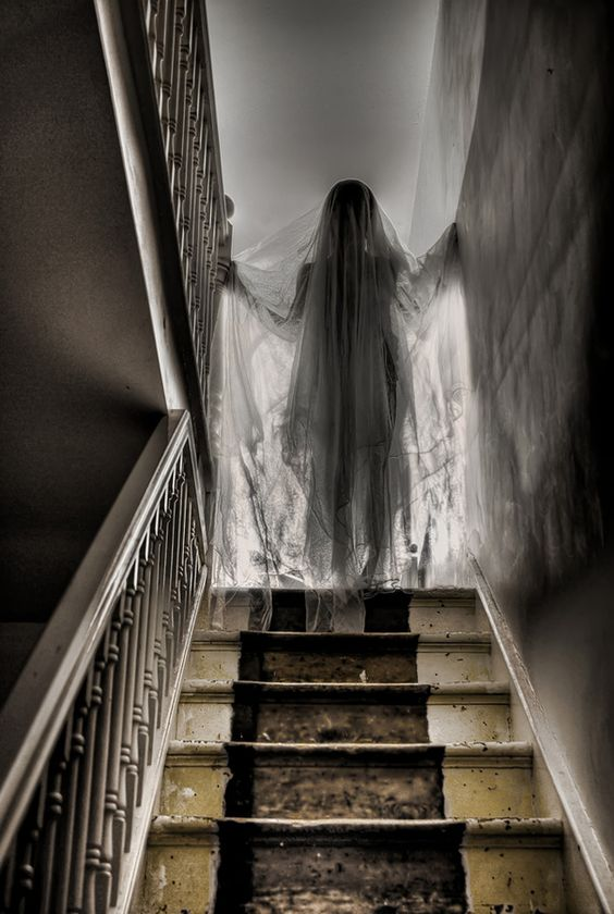 Use a mannequin or a sewing form with a styrofoam wig head covered with dark fabric and then draped in tulle or gauze positioned at the top of the stairs if you don't want guests going up there during your Halloween Party.  2: