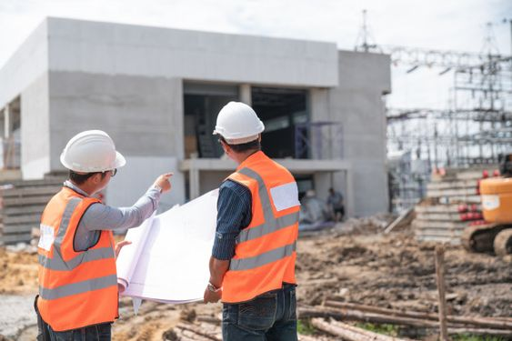 Construction engineers discussion with architects at construction site Premium Photo