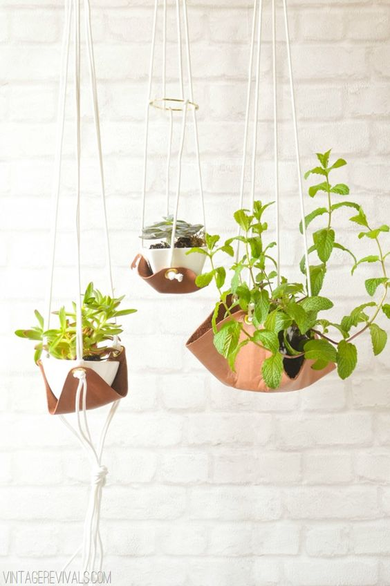These suspended hanging planters via Vintage Revivals are not only easy to make, but looks oh-so-modern.