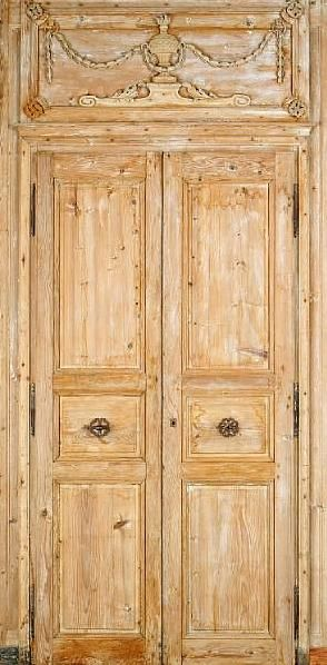 Beautifully aged natural light wood, the details over the doors, paneling, adore the handles.