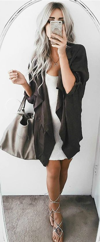 Minimalist draped trench coat/cardigan with little white dress and gray bag/purse