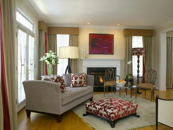 The client's love of the painting over the fireplace is the inspiration for this contemporary living room's design. A sense of formality and sophistication was enlivened with pops of crimson throughout the living room.