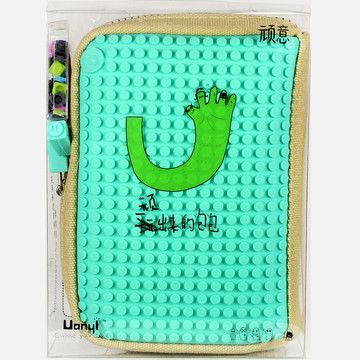 Uanyi is looking to change the way you accessorize your accessories. The Japanese company is taking everyday carriers like backpacks and iPhone 5 cases and turning them into interactive pieces with complete customization ability. Use the included pixels to make your gear ultra unique. It's 8-bit awesome