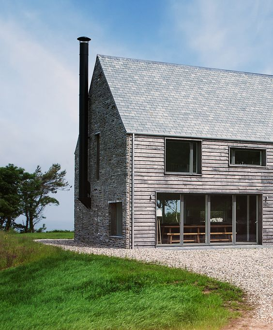 Mortehoe house oak clad with a stone gable www for Modern barn house