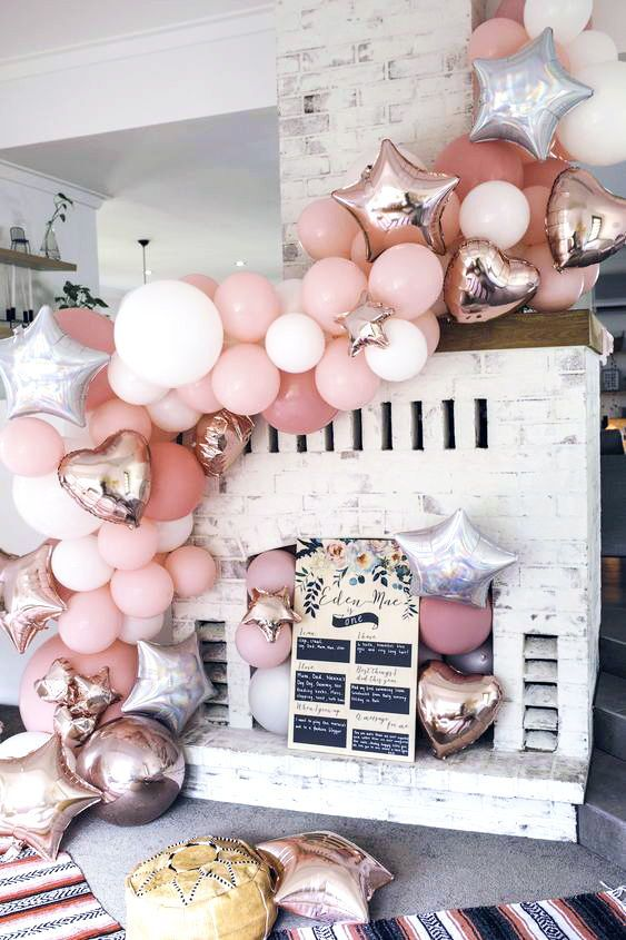 A pink balloon garland! | Bohemian Brunch for Eden Mae's 1st Birthday | HOORAY! Mag | 1st Birthday | Celebration | Party Planning | Pink Pastel Balloons | Balloon Garland | Metallic Foil Balloon | Party Decoration | Party Inspiration | Floral Bohemian Party | Pastel Flowers | Boho Vibe | Donut Wall |