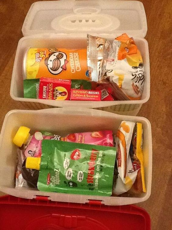 Old baby wipes container for long trips with kids. Pack a box of snacks for each kid or lil entertainment boxes.
