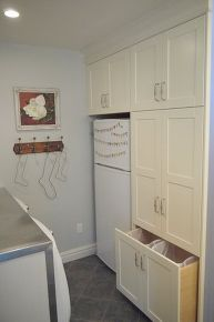 laundry room makeover in 1918 farmhouse, doors, home decor, home improvement, laundry rooms, Extra fridge and pull out laundry hamper and lots more storage