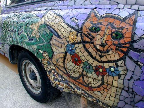 mosaic cat-on-a-car