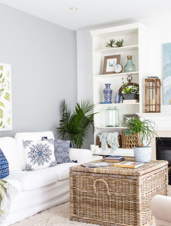 Coastal Style using a trunk as a coffee table allows for some more extra storage. wicker truck