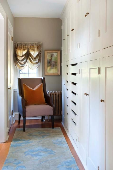 Wall-to-wall storage is a coveted feature in any home, but to be done so stylishly in the bedroom is the envy of every homeowner. The built-in cabinets with brass knobs and pull-out drawers are a functional stand-in for a regular closet and they make use of the space in the hallway.