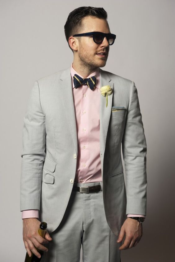Love the gray suit and bow tie. Switch the pink for a color more