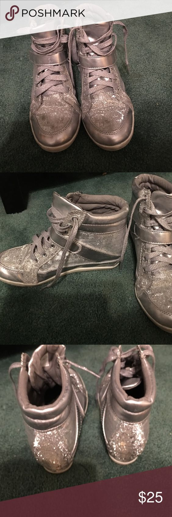 Silver mesh bling high top sneakers Size 7 .... Add a little style to your jeans. Sweet silver hi top sneakers. For you or a young girl. All the outside is in very good condition. No tears or worn areas Justice Shoes Sneakers