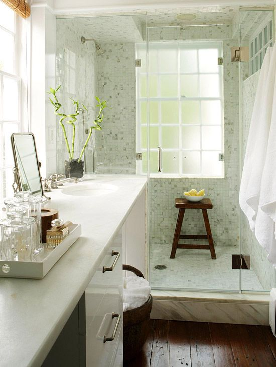 Create an expansive look with wall-to-wall glass shower doors and white woodwork.