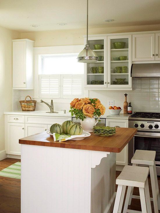 Beaded board and simple subway tile gives a kitchen cottage style. More kitchen island inspiration: http://www.bhg.com/kitchen/island/island-design-ideas/?socsrc=bhgpin090212beadedboardkitchen