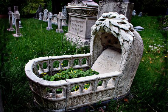 """A child's grave. Mary Wigglesworth. Mt Auburn Cemetery. Cradle holds an infant's name and date of birth/death, carved upon a stone pillow. """"toward the back of the cemetery... away from Mount Auburn Street.""""  KarenMarleneLarsen on flickr"""