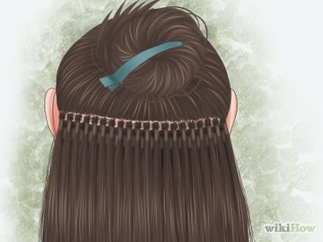 Apply Hot Fusion Hair Extensions Step 4.jpg