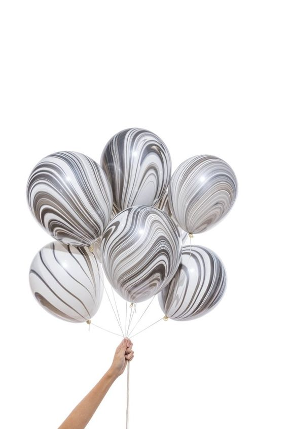 """Give your party that fancy finishing touch with some hand-dipped marbled balloons! Dimensions: Balloons measure 11"""" in diameter. Details: Contains 8 hand-dipped balloons. Erin Ozer launched Knot & Bow"""